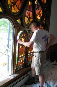 Taking out a stained glass panel